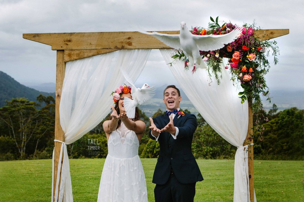 Wedding doves flew over the guests, see the joy on Blair and Jasmine's face. Photograph - Tall Timber Studios